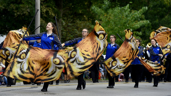 Members of the carthage High School drill team entertain the crowd during the 53rd Annual Maple Leaf Parade in Carthage on Saturday.<br /> Globe | Laurie Sisk