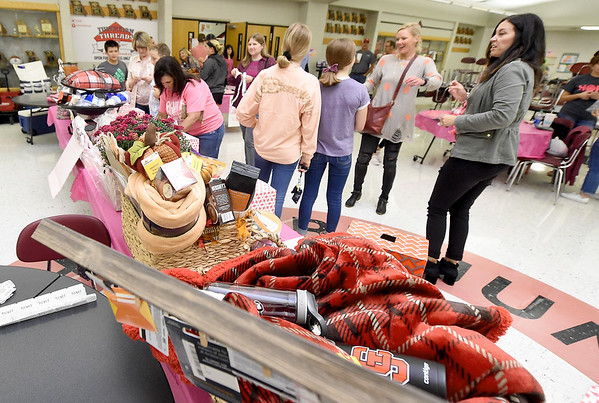Guests check out the numerous raffle and silent auction items during the The 2019 Pink Out on Tuesday night at Carl Junction High School. The event, in its 12th year, raised $3,975 to benefit the Hope 4 You Breast Cancer Foundation.<br /> Globe | Laurie Sisk