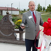 Bob Headlee, chairman of the Rotary Sculpture Garden, welcomes visitors during Thursday's ribbon cutting of the garden at Mercy Park.<br /> Globe | Roger Nomer