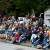 Spectators line the street near Macon street during the 53rd Annual Maple Leaf Parade in Carthage on Saturday.<br /> Globe | Laurie Sisk