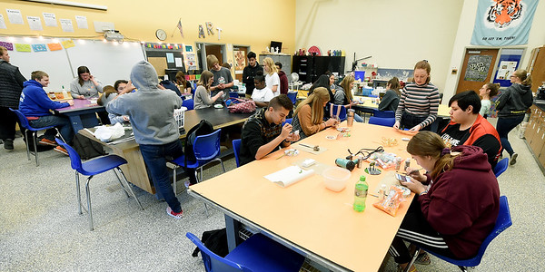 Carthage High School students work on Christmas ornaments honoring the state of Missouri on Tuesday at CHS. The 24 ornaments designed by CHS students will decorate a Christmas tree representing Missouri in the nation's capitol.<br /> Globe | Laurie Sisk