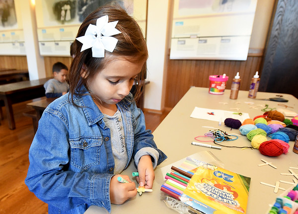 Jasmine Escobedo, 7, of Joplin, decorates a Guatemalan worry doll during Hispanic Heritage Day on Saturday at George Washington Carver National Monument. The event also featured arts and crafts, food and more.<br /> Globe | Laurie Sisk