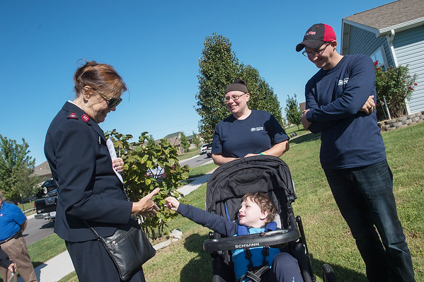 Salvation Army Major Gail Aho greets Kristen Asbell, Dillon Sprague and their son Dominic, 4, before the groundbreaking for the family's Habitat home on Monday in Joplin.<br /> Globe | Roger Nomer
