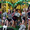 Members of the Joplin High School Dance Team wave to the crowd from their jungle themed float during the 2019 JHS Homecoming Parade on Wednesday night on Main street.<br /> Globe | Laurie Sisk