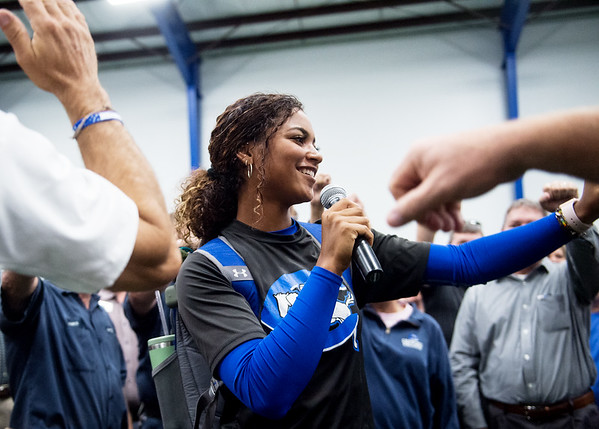 Shandra Jackson, Crowder College sophomore and member of the softball team, asks donors to put their hands in the center of a circle to celebrate the opening of the Freeman Fieldhouse on Tuesday.<br /> Globe | Roger Nomer