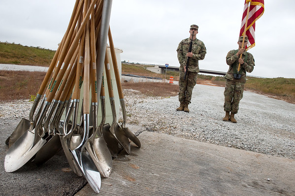 Members of the Army National Guard present the colors before Tuesday's groundbreaking of the Bella Vista Bypass near Gravette. <br /> Globe | Roger Nomer
