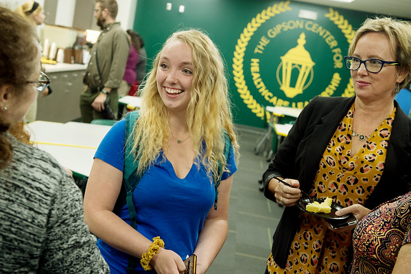 Mikali Cutbirth, a Missouri Southern freshman from Carthage, left, and Michelle Wood, director of major gifts for Missouri Southern, talk to visitors on Tuesday during an open house for the Gipson Center for Health Care Leadership.<br /> Globe | Roger Nomer