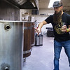 Nate Artinger talks about his brewing process at Beard Engine on Thursday in Alba.<br /> Globe | Roger Nomer