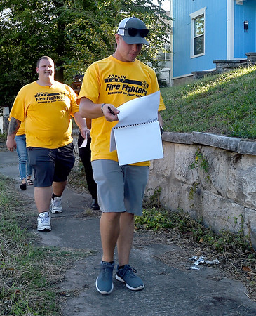 Joplin firefighters Ethan Kennedy, front and Jeff Gallant, back canvass a neighborhhod earlier this month near B and Joplin streets for Prop B, which is a half cent sales tax dedicated to funding police and fire retirement plans in the hopes of improving retention and recruitment. <br /> Globe   Laurie Sisk