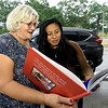 ESL instructor Rhonda Wyrsch and Lillian Hernandez reminisce as they look through a book of photographs of classes and activities of the first three years of the Carthage Public Library Citizenship Class during a reunion on Saturday at Municipal Park.<br /> Globe | Laurie Sisk