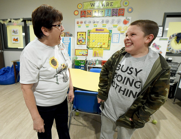 From the left: RISE high school teacher Eileen Pierson shares a laugh with RISE student Brandon Taylor, 11, of Baxter Springs during an open house Thursday at the school.<br /> Globe | Laurie Sisk