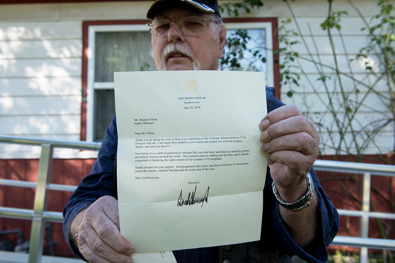Maurice Filson diplays a letter he received from President Donald Trump about the United States Department of Veterans Affairs. Globe | Roger Nomer