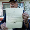 Maurice Filson diplays a letter he received from President Donald Trump about the United States Department of Veterans Affairs.<br /> Globe | Roger Nomer