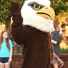 Joplin High School mascot Eddie the Eagle waves to the crowd during the 2019 JHS Homecoming Parade on Wednesday night on Main street.<br /> Globe | Laurie Sisk