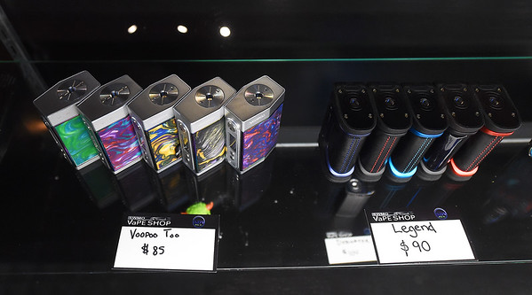 Atomizers line a shelf at SWMO Vapes on Wednesday. Local governments are considering raising the legal age to buy tobacco and vaping supplies to 21.<br /> Globe | Laurie Sisk