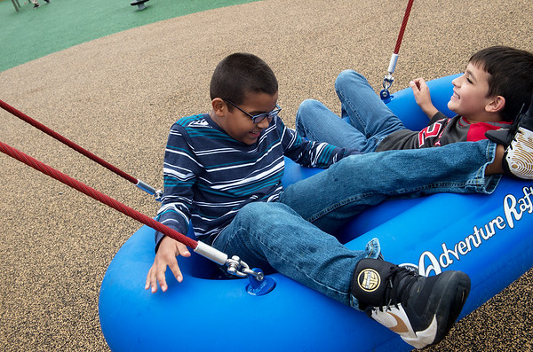 Douglas Smith, left, and Christian Robertson, third grade, play at the Power of Play playground in Carl Junction on Thursday.<br /> Globe | Roger Nomer