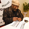 Walter Morris fills out a voter registration form during the Joplin Chapter of the NAACP's Chili Feed and Voter Registration on Saturday at Shiloh Missionary Baptist Church.<br /> Globe | Laurie Sisk