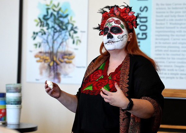 Dressed in Dia de los Muertos costume, natalie Mast, of Joplin, shares the history of sugar skulls during Hispanic Heritage Day on Saturday at George Washington Carver National Monument. The skulls are painted and were often used by families who could not afford gravestones.<br /> Globe | Laurie Sisk
