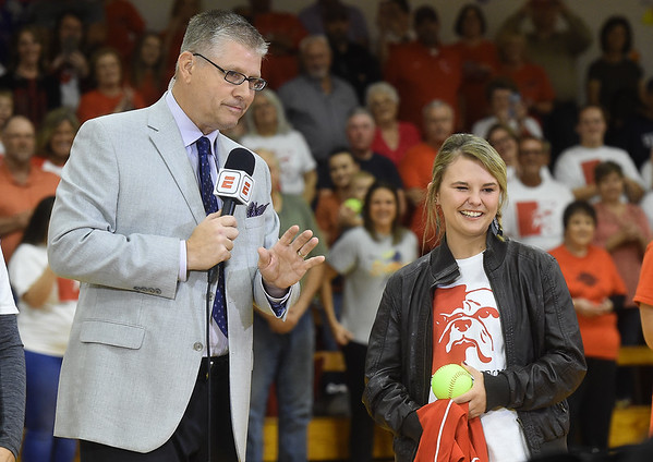 ESPN Sportcenter anchor John Anderson, left,  recognizes Liberal softball player Brooke Bearden as a Sportscenter Top 10 during a live ESPN broadcast on Thursday morning at Liberal High School. Brooke was acknowledged for her courage after suffering a stroke.<br /> Globe | Laurie Sisk