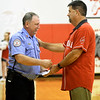 Liberal Schools Superintendent Bill Harvey, right, thanks xx xx during a recognition ceremony recently at Liberal High School.<br /> Globe | Laurie Sisk