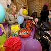 Four-year-old ninja Gatlin Farmer, of Sarcoxie, gets a treat from Ashley Keaton at her Candyland themed booth during the SWX Athletics Trunk or Treat event on Thursday night at SWX. The free event featured several themed booths, vendors, a photo booth, dance party, food truck and more. About 100 kids attended the event. <br /> Globe | Laurie Sisk