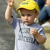 Two-year-old Tucker Davis waves as a band passes by during Missouri Southern's 2019 Homecoming Parade on Saturday at MSSU.<br /> Globe | Laurie Sisk