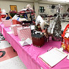 Guests check out numerous raffle and silent auction items during the The 2019 Pink Out on Tuesday night at CJHS. The event, in its 12th year, raised $3,975 to benefit the Hope 4 You Breast Cancer Foundation.<br /> Globe | Laurie Sisk
