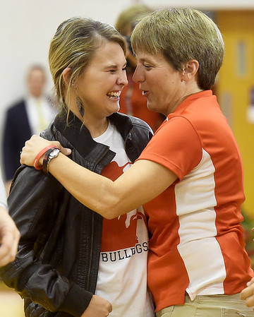 From the left: Liberal softball player Brooke Bearden gets a hug from coach Brandi Goodell after Bearden was recognized as an ESPN Top 10 in a live ESPN broadcast on Thursday at Liberal High School.<br /> Globe | Laurie Sisk