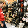 Thomas Hasler checks out the selection of scary masks while shopping Wednesday at Spirit Halloween.<br /> Globe | Laurie Sisk