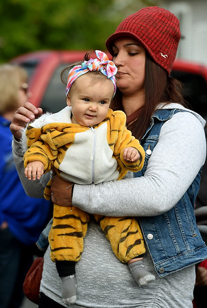 Eight month old Ada Mueller takes in the sights and sounds of her first Maple Leaf Parade while in the arms of her mother, Kylie Mueller. Ada was one of tens of thousands of spectators to take in the 53rd Annual Maple Leaf Parade in Carthage on Saturday.<br /> Globe | Laurie Sisk