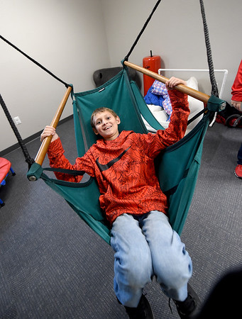 Daniel Brynds, son of RISE para Donna Benedict, checks out a swing in the senory room at the school during an open house on Thursday. The room is used for students who need to burn off extra energy when upset, anxious or otherwise over stimulated.<br /> Globe | Laurie Sisk