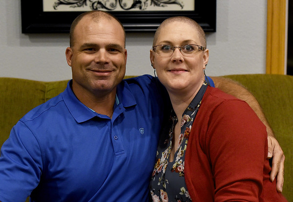Jason Banwart, left,  and Elizabeth Banwart pose for a photo in their Liberal home on Wednesday.<br /> Globe | Laurie Sisk