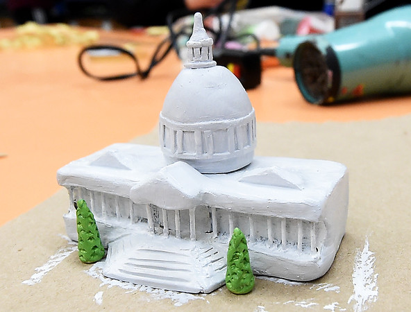 Carthage High School senior's tiny scale of the state capitol sits waiting a few final touches and placement inside a clear ornament on Tuesday at CHS. The 24 ornaments designed by CHS students will decorate a Christmas tree representing Missouri in the nation's capitol.<br /> Globe | Laurie Sisk