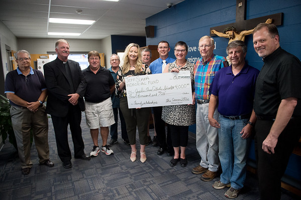 The Jeff Slama Memorial Fund presents $4,000 from funds raised during the 2018 Jeff Slama Memorial Chili Competition to Emily Yoakam, principal of McAuley High School and St. Peters Middle School, left, and Georgiana McGriff, director of schools for Joplin Area Catholic Schools, on Wednesday at McAuley High School. The money will be used for scholarships to help students stay in the Catholic schools system. The 2019 chili competition will be held on Oct. 5 from 5:30-730 p.m. in the McAuley Catholic Multi-Purpose Room.<br /> Globe | Roger Nomer