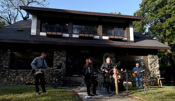 Members of the alternative rock band Higher Ed - comprised of Missouri Southern professors and a Thomas Jefferson librarian - perform during Porchfest, a grassroots music festival taking place on various porches in the North Heights neighborhood of Joplin. The event featured 24 bands, a food truck alley and local artists displaying their goods.<br /> Globe | Laurie Sisk
