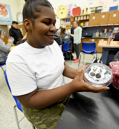 Carthage High School junior Mykila Triplet holds her snowglobe recognizing Route 66 on Tuesday at CHS. The 24 ornaments designed by CHS students will decorate a Christmas tree representing Missouri in the nation's capitol.<br /> Globe | Laurie Sisk