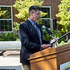 Mark Rasor, interim president of NEO University, reads a proclamation during the unveiling ceremony for the Centennial Tribal Monument at NEO on Monday.<br /> Globe | Roger Nomer