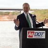 Arkansas State Rep. Dan Douglas talks during Tuesday's groundbreaking of the Bella Vista Bypass near Gravette.<br /> Globe | Roger Nomer