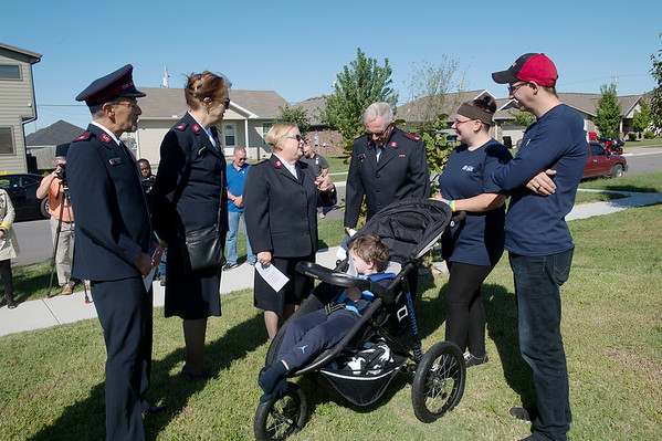 (from left) Salvation Army Majors Phil and Gail Aho and Beckie and Doug Stearns talk with Kristen Asbell and Dillon Sprague, and their son Dominic, 4, before the groundbreaking for the family's Habitat home on Monday in Joplin. Globe | Roger Nomer