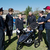 (from left) Salvation Army Majors Phil and Gail Aho and Beckie and Doug Stearns talk with Kristen Asbell and Dillon Sprague, and their son Dominic, 4, before the groundbreaking for the family's Habitat home on Monday in Joplin.<br /> Globe | Roger Nomer