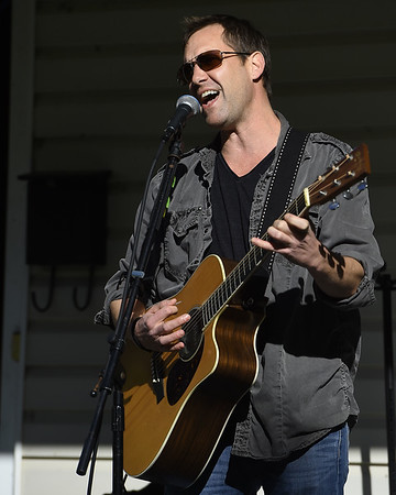 Jason Kinney covers a Led Zeppelin song as he and his band join 23 other bands for Porchfest, a grassroots music festival taking place on various porches in the North Heights neighborhood of Joplin. The event also featured a food truck alley and local artists displaying their goods.<br /> Globe | Laurie Sisk