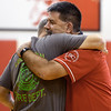 Liberal Schools Superintendent Bill Harvey, right, hugs Liberal Rural Fire Department Chief Brent Henshaw during a recognition ceremony recently at Liberal High School.<br /> Globe | Laurie Sisk