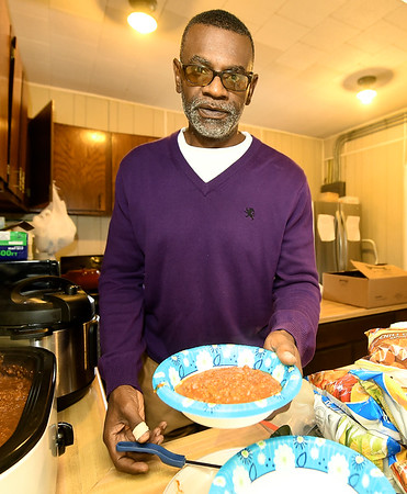President Victor Sly offers up a bowl of hot chili during the Joplin Chapter of the NAACP's Chili Feed and Voter Registration on Saturday at Shiloh Missionary Baptist Church.<br /> Globe | Laurie Sisk