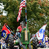 An antique tractor is adorned with flags honoring each branch of the military during the 53rd Annual Maple Leaf Parade in Carthage on Saturday.<br /> Globe | Laurie Sisk