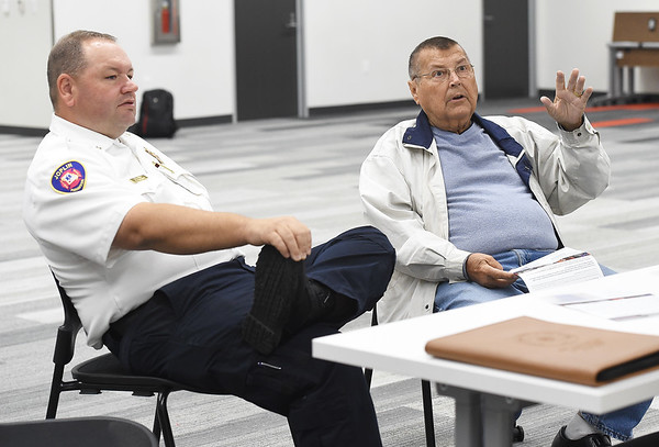 Joplin resident and retired Kansas City firefighter Bill Murray , right, chats with Joplin Chief James Ferguson, left and other representatives of the JFD during an informational meeting at the Joplin Public Library earlier this month for Prop B, which is a half cent sales tax dedicated to funding police and fire retirement plans in the hopes of improving retention and recruitment. <br /> Globe | Laurie Sisk