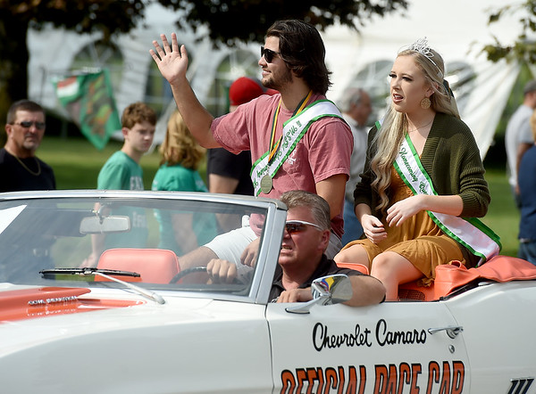 From the left: Homecoming King Brandon O'Connell and Homecoming Queen Kailey Halland wave to the crowd during Missouri Southern's 2019 Homecoming Parade on Saturday at MSSU.<br /> Globe | Laurie Sisk