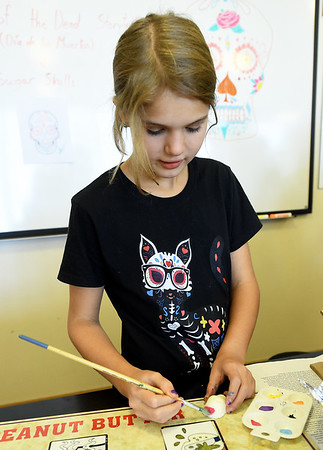 Claire Smith, 11, of Joplin, decorates a sugar skull during Hispanic Heritage Day on Saturday at George Washington Carver National Monument. The event also featured performances, food and more.<br /> Globe | Laurie Sisk