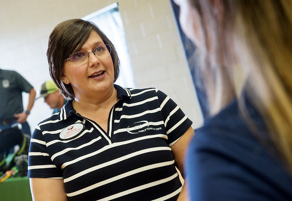 Elsie Morris, vocational specialist services coordinator at Franklin Tech, left, talks with Lilly Ann Masters, president of the Joplin FFA, during an Ag Day at the high school on Sept. 19.<br /> Globe | Roger Nomer