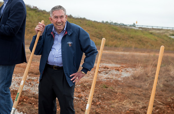 Bobby Hopper smiles proudly after helping shovel dirt Tuesday's groundbreaking of the Bella Vista Bypass near Gravette. Hopper is the longest serving Arkansas Highway commissioner, serving 16 years before his retirement.<br /> Globe | Roger Nomer