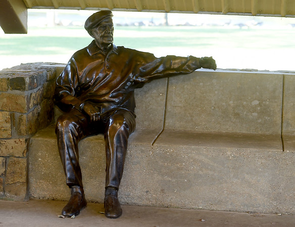 """A statue of Tal Wooten inside the Moore-Wooten Plaza urges visitors to Jolly Mill Park to """"Please sit, rest, get a hug.""""<br /> Globe   Laurie SIsk"""